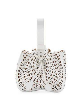 ALAIA Lux Laser Cut Bucket Bag, White $2,055 thestylecure.com
