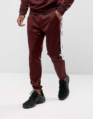 Illusive London Skinny Track Joggers In Burgundy With Taping