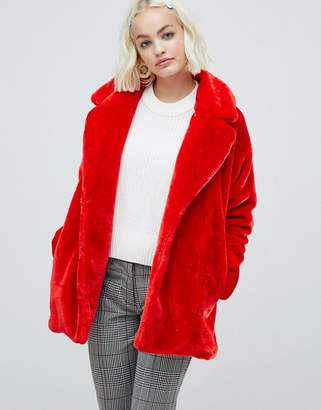 Monki faux fur jacket in red