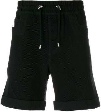 Balmain perforated track shorts
