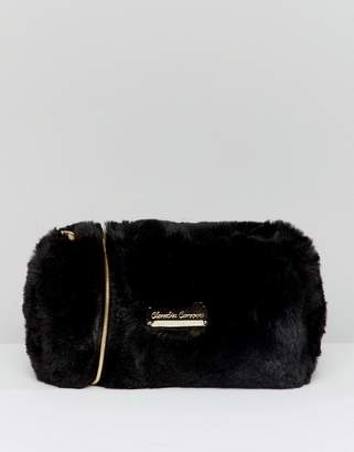 fd348b18ca47 Claudia Canova soft faux fur cross body bag with zip top opening and metal  detail