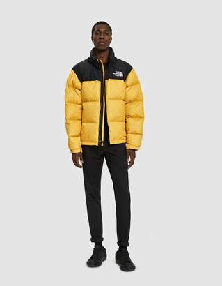 The North Face Black Box 1996 RTO Nuptse Down Jacket in TNF Yellow