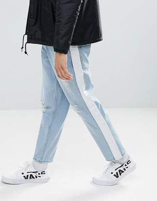 Asos DESIGN Skater Jeans In Light Wash With Abrasions And Side Stripe