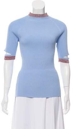 Nomia Mock Neck Cutout Sweater