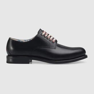 Gucci Black leather lace-up shoe
