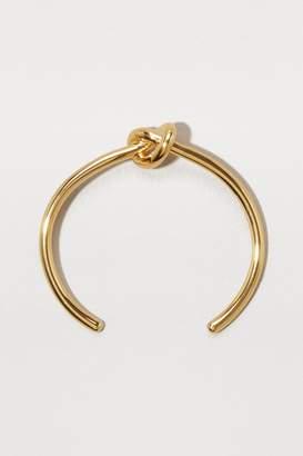 Celine Knot Extra-Thin gilded brass bracelet