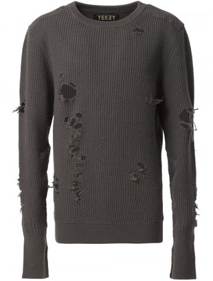 Yeezy distressed knit sweater $2,600 thestylecure.com