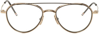 Thom Browne Gold & Black TB 109 Aviator Glasses $650 thestylecure.com