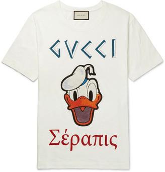 Gucci + Disney Appliquéd Printed Cotton-Jersey T-Shirt $750 thestylecure.com