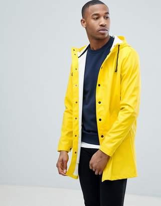 Asos DESIGN shower resistant rain coat in yellow