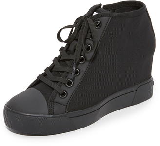 DKNY Cindy Mesh Wedge Sneakers $198 thestylecure.com