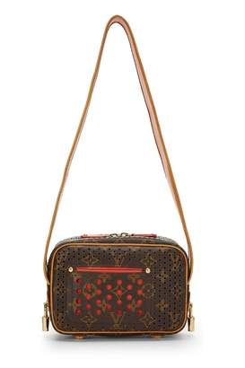 c8f394318341 Louis Vuitton Limited Edition Orange Monogram Perforated Trocadero Mini