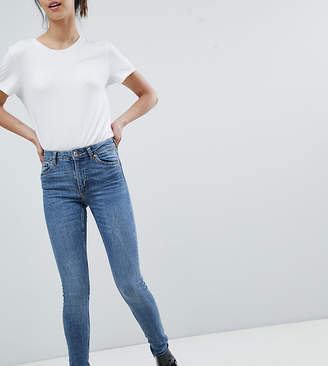 e83978a5f622 Monki Mocki mid waist slim jeans with organic cotton in mid blue
