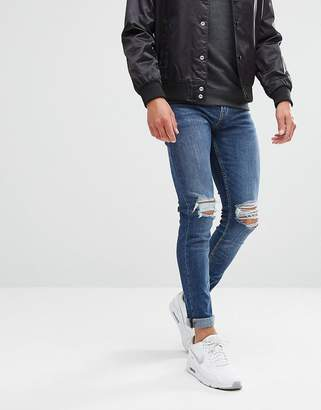 New Look Skinny Jeans With Knee Rip In Mid Blue Wash