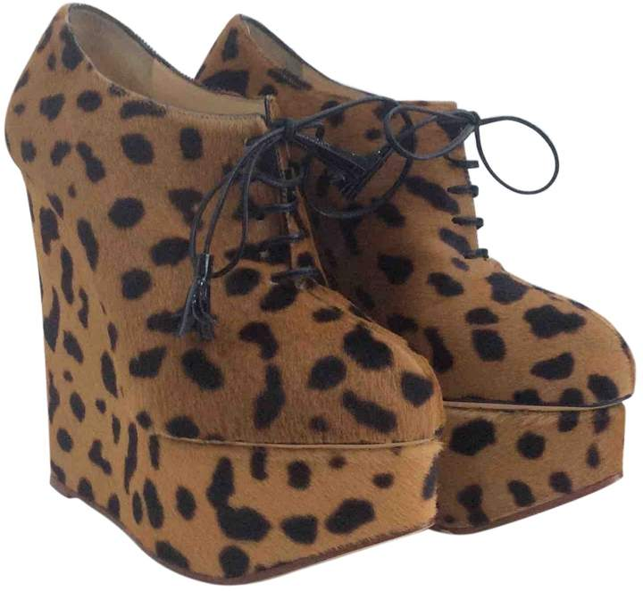 Pony-style calfskin boots