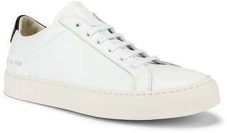 reputable site ab85a fc2f1 Common Projects Leather Achilles Retro Low in White   Black   FWRD