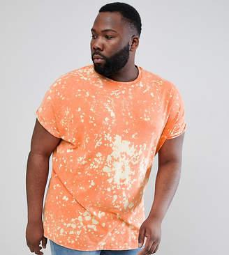 Asos DESIGN Plus oversized t-shirt with random bleach wash in orange