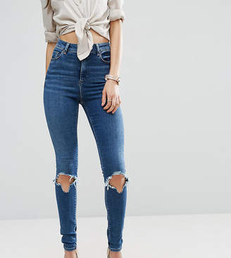 Asos Tall DESIGN Tall Ridley skinny jeans in roy dark stonewash with busted knees