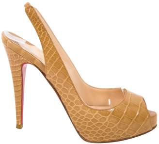 Christian Louboutin Private Number alligator heels
