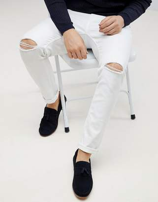 Asos DESIGN skinny jeans in white with knee rips