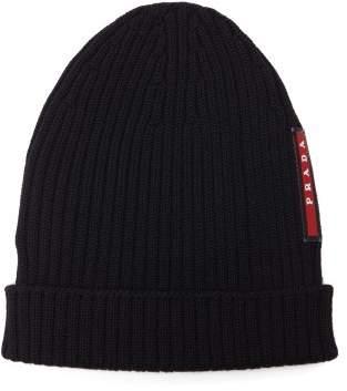 Prada - Logo Embellished Ribbed Knit Beanie Hat - Mens - Black