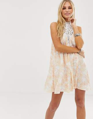 En Creme swing dress with lace top in pastel floral