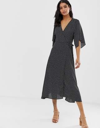 Liquorish maxi wrap dress with tie waist detail in polka dot