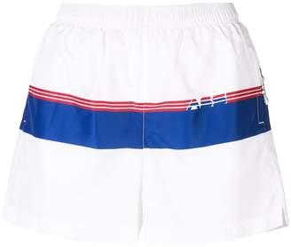 Adam Selman logo stripe track shorts