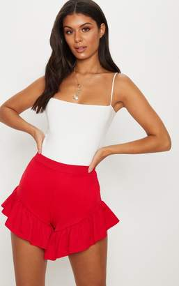 PrettyLittleThing Red Extreme Frill Hem Short