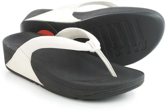 FitFlop Swirl T-Strap Flip-Flops - Leather (For Women) $39.99 thestylecure.com