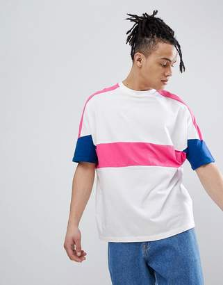 Asos DESIGN oversized t-shirt with roll sleeve and bright color block