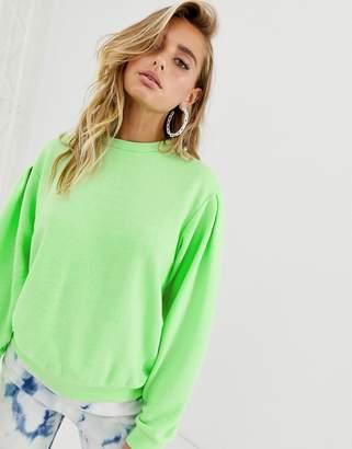 Asos Design DESIGN oversized sweatshirt in washed neon