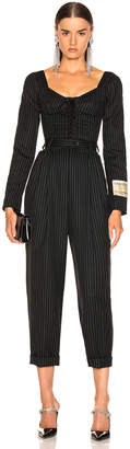 Dolce & Gabbana Long Sleeve Pinstriped Jumpsuit in Black | FWRD