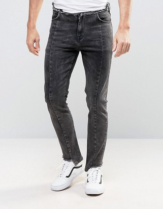 ASOS Skinny Jeans With Stepped Hem And Raw Waistband In Washed Black $53 thestylecure.com
