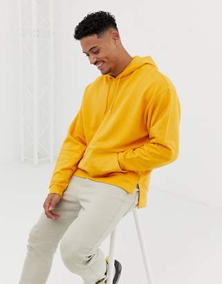 Asos Design DESIGN oversized hoodie with stepped hem and dropped shoulder in yellow