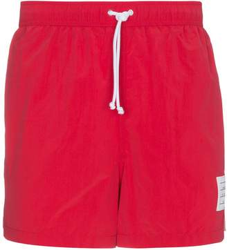 Thom Browne Red swim shorts with stripe detail