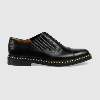 Gucci Leather lace-up with star trim