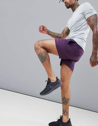 Asos 4505 training shorts in mid length in purple