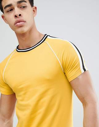 Asos DESIGN muscle fit raglan t-shirt with taping and piping in yellow