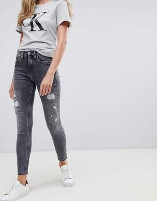 Calvin Klein high rise slashed skinny jeans