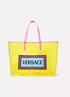 a8e420f7bfca Versace Appliquéd Leather-trimmed Vinyl Tote - Yellow