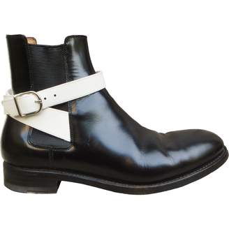 Balenciaga Patent leather buckled boots