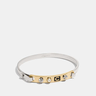 COACH Coach Icons Tension Bangle $95 thestylecure.com
