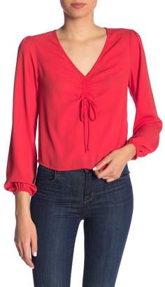Ro & De Cinch Front Long Sleeve Blouse