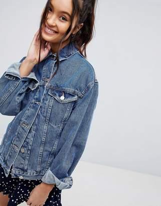 Asos DESIGN denim girlfriend jacket in midwash blue