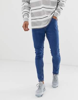 3de53a2514 Bershka super skinny jeans in mid blue