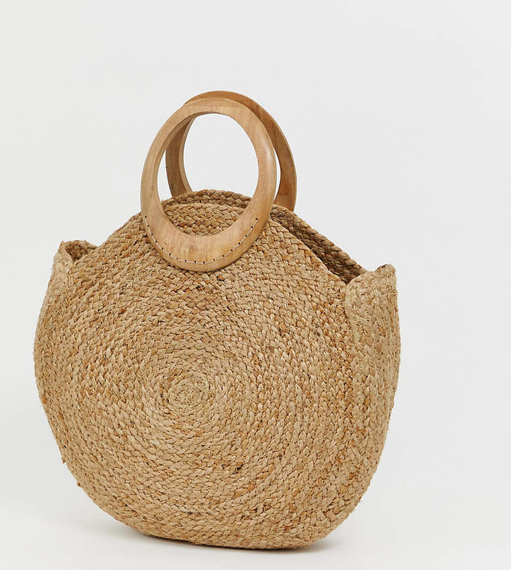 Accessorize straw circular tote bag with wood effect handle