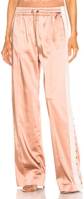 Jonathan Simkhai Crepe Satin Combo Track Pant in Pink Sand & Nude | FWRD