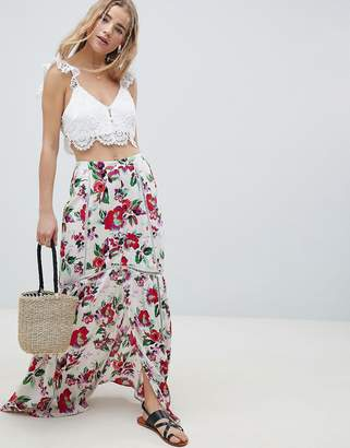 Asos DESIGN crinkle maxi skirt with lace trim detail in print