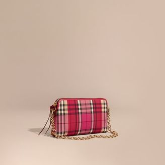 Burberry Overdyed Horseferry Check and Leather Clutch Bag $1,150 thestylecure.com